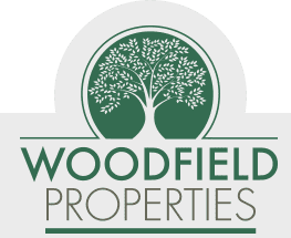 Woodfield Properties logo.